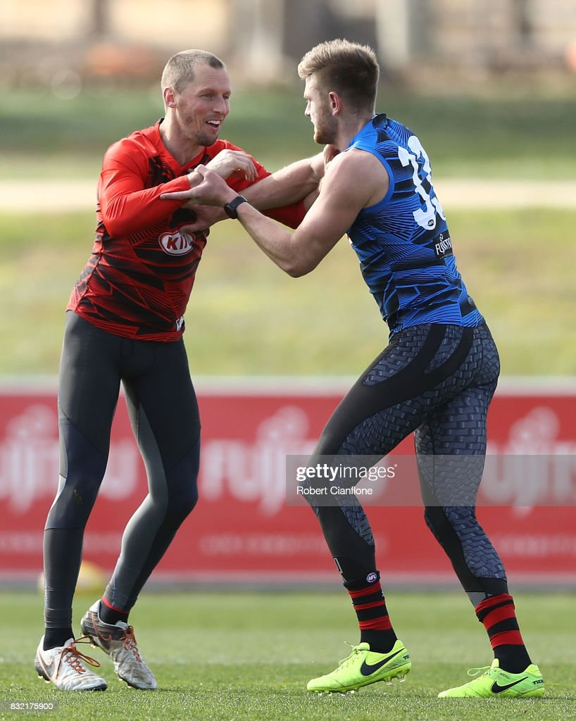 James Kelly of the Bombers wrestles with Jayden Laverde of the Bombers during an Essendon Bombers AFL training session at the Essendon Football Club on August 16, 2017 in Melbourne, Australia.