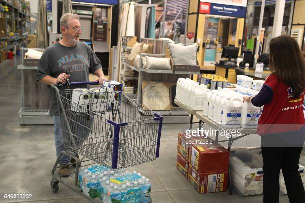 James Kelly shops at a Lowe's store on the day the company reported a rise in earnings on March 1 2017 in Hialeah Florida Lowe's reported...