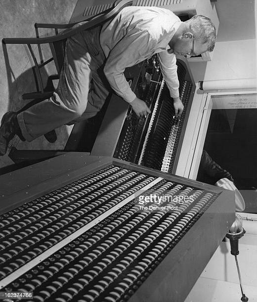 SEPT 20 1953 James kenna Denver Civic theater technical director Plays the console which activates the stage lights by pushbutton after the lighting...