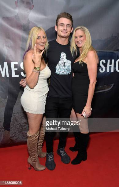 James Kennedy poses with fans at the Los Angeles launch party for JamesKennedyshop at SUR Lounge on October 23 2019 in Los Angeles California