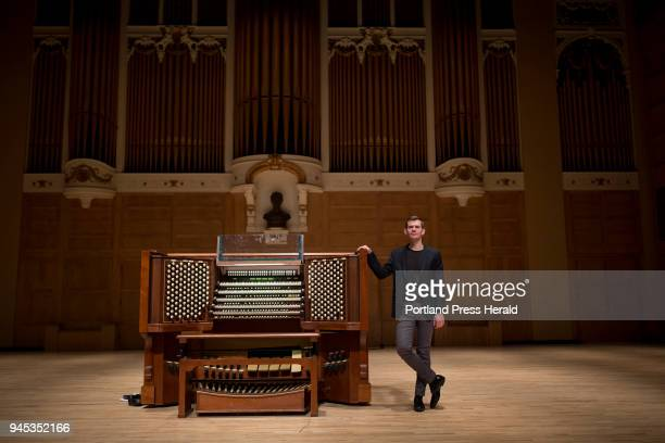 James Kennerley Portland's new municipal organist poses for a portrait onstage at Merrill Auditorium with the Kotzschmar organ Kennerley who is based...
