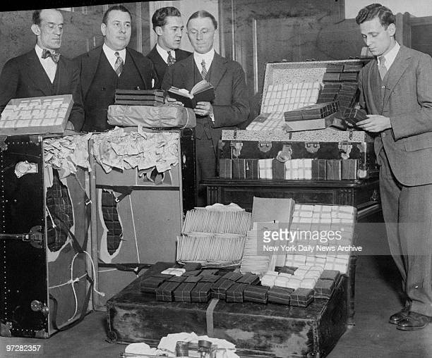 James Kerrigan John M Blake Thomas McGuire Charles H Tuttle and Alvin Sylvester look over the drug haul that they seized