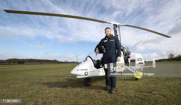 James Ketchell next to his open cockpit gyrocopter at Popham Airfield in Hampshire.