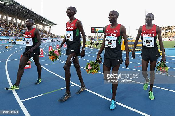 James Kiplagat Magut, Asbel Kiprop, Silas Kiplagat and Collins Cheboi of Kenya walk off the track after winning and setting a new world record of...