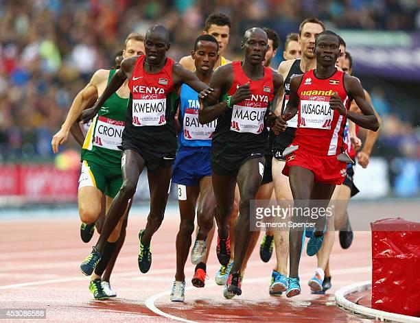 James Kiplagat Magut of Kenya and Ronald Kwemoi of Kenya ccompete the Men's 1500 metres final at Hampden Park during day ten of the Glasgow 2014...
