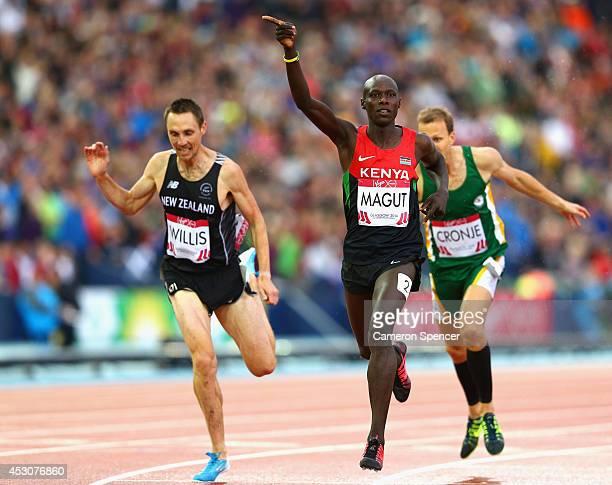 James Kiplagat Magut of Kenya crosses the line to win gold ahead of bronze medalist Nick Willis of New Zealand in the Men's 1500 metres final at...