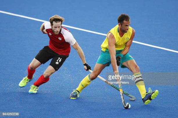 James Kirkpatrick of Canada competes for the ball with Mark Knowles of Australia during the Men's Pool A match between Australia and Canada on day...