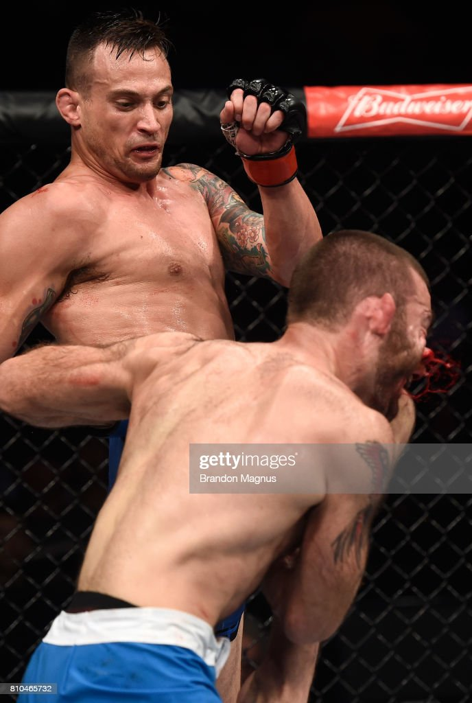 James Krause knees Tom Gallicchio in their welterweight bout during The Ultimate Fighter Finale at T-Mobile Arena on July 7, 2017 in Las Vegas, Nevada.