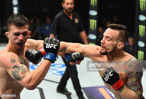 James Krause punches Alex White in their lightweight bout during the UFC Fight Night event inside the Scottrade Center on January 14 2018 in St Louis...