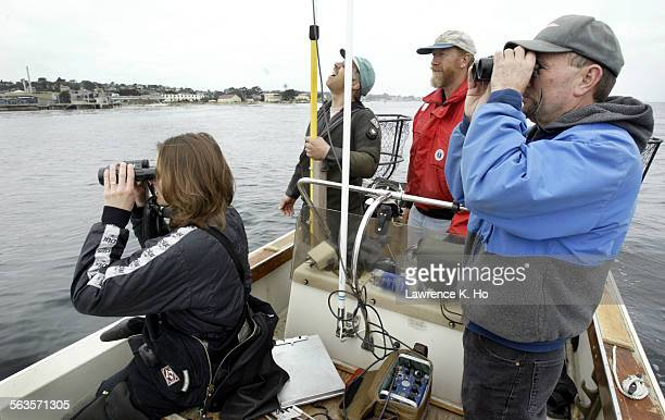 James L. Bodkin of the US Geological Survey, Biological Resources with members of sea otter research team scanning the Monterey Bay for sea otters to...
