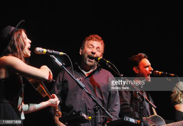 James L Dolan Marc Copely and Erin Slaver of JD The Straight Shot perform at The Paramount Theater on July 12 2019 in Huntington New York