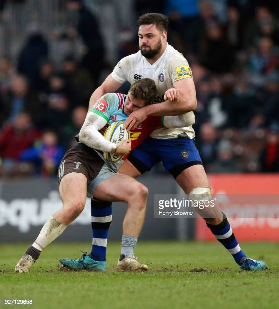 James Lang of Harlequins tackled by Elliott Stooke of Bath Rugby during the Aviva Premiership match between Harlequins and Bath Rugby at Twickenham...