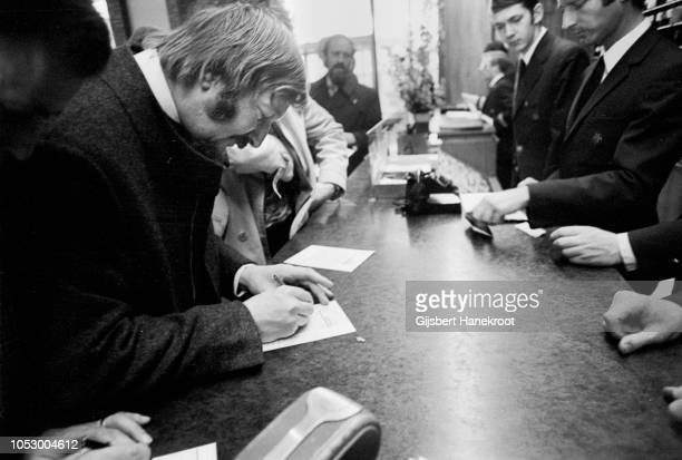 James Last checking in at the Hilton Hotel Amsterdam Netherlands February 1970
