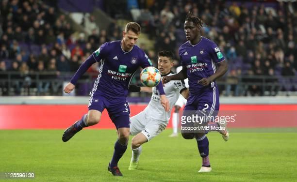 James Lawrence of Anderlecht Yuta Toyokawa of Kas Eupen and Mbodji Kara of Anderlecht fight for the ball during the Jupiler Pro League match between...