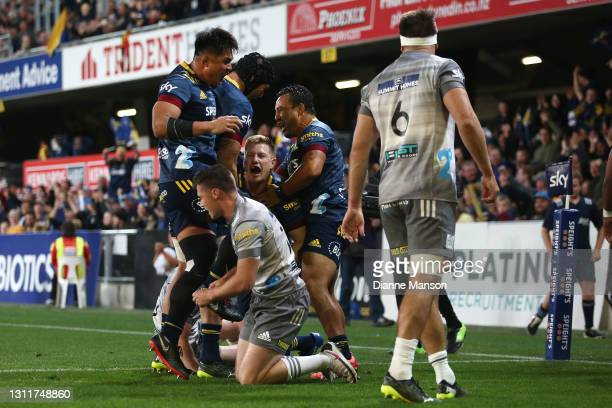 James Lentjes of the Highlanders dives over to score a try during the round seven Super Rugby Aotearoa match between the Highlanders and the Chiefs...