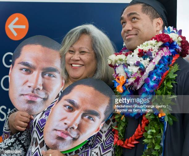 James Lesu'i 25 wears many faces at the Cal State Fullerton graduation ceremony He was with his mom Julia Lesu'i after graduating with a Bachelors of...