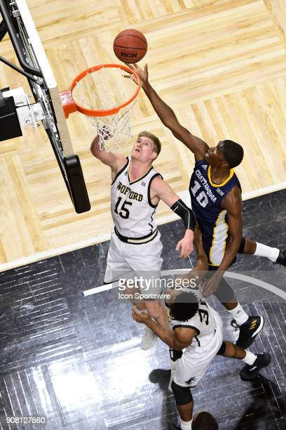 James Lewis Jr forward University of Tennessee Chattanooga Mocs taps the ball in over Trevor Stumpe guard Wofford College Terriers Saturday January...