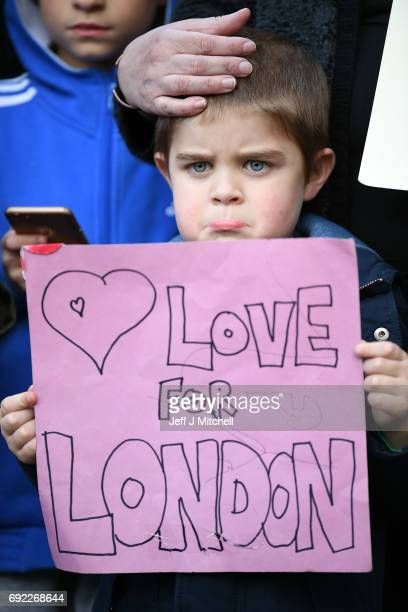 James Little aged 5 holds up a message for the victims of the London terrorist attacks at the County Hotel on June 4 2017 in Carlisle England...