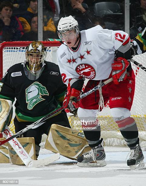 James Livingston of the Sault Ste. Marie Greyhounds waits to deflect a shot next to Jhase Sniderman of the London Knights in a game on February 24,...