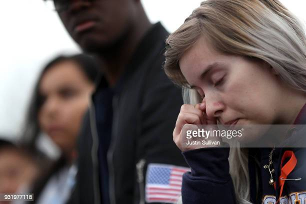 James Logan High School student wipes her eye during a walk out demonstration on March 14 2018 in Union City California Students across the nation...
