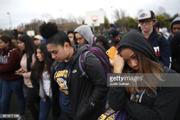 James Logan High School students observe a moment of silence during a walk out demonstration on March 14 2018 in Union City California Students...