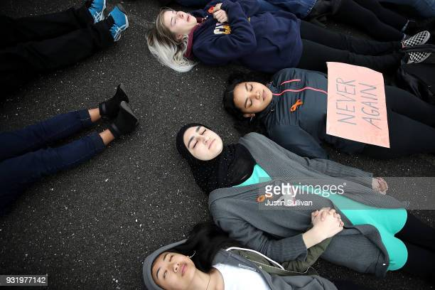 James Logan High School students stage a die in during a walk out demonstration on March 14 2018 in Union City California Students across the nation...