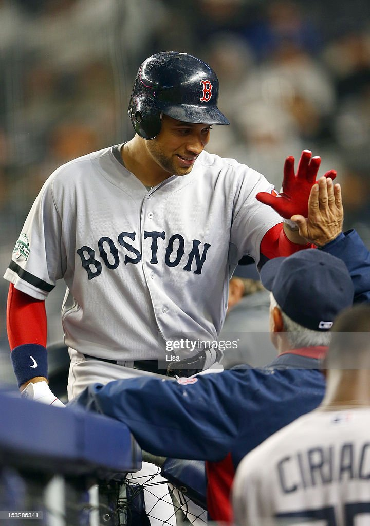 James Loney #22 of the Boston Red Sox is congratulated by manager Bobby Valentine #25 after Loney scored a home against the New York Yankees on October 2, 2012 at Yankee Stadium in the Bronx borough of New York City.