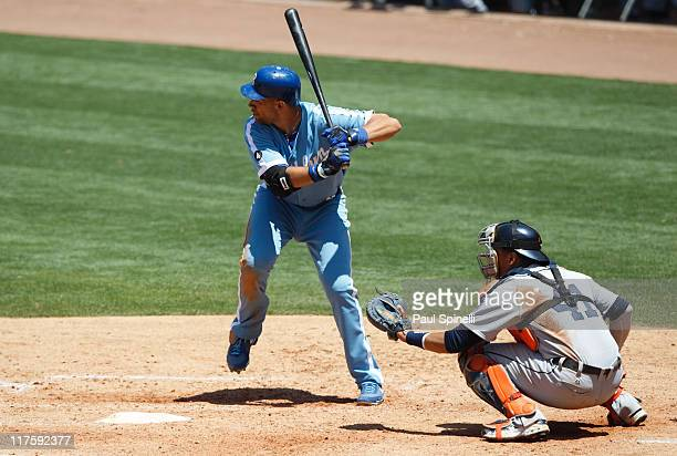 James Loney of the Los Angeles Dodgers bats as catcher Victor Martinez of the Detroit Tigers catches during the game on June 22 2011 at Dodger...
