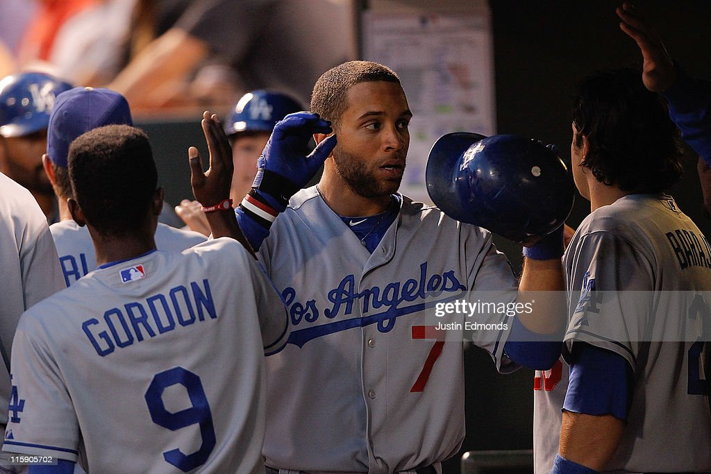 James Loney #7 of the Los Angeles Dodgers is greeted by teammates Dee Strange-Gordon #9 and Rod Barajas #28 in the dugout after scoring in the eighth inning against the Colorado Rockies at Coors Field on June 11, 2011 in Denver, Colorado. The Dodgers defeated the Rockies 11-7.