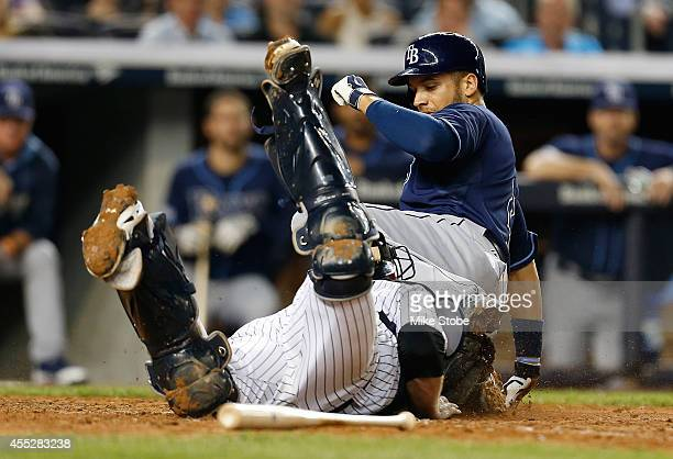 James Loney of the Tampa Bay Rays is tagged out by Brian McCann of the New York Yankees trying to score in the sixth inning at Yankee Stadium on...