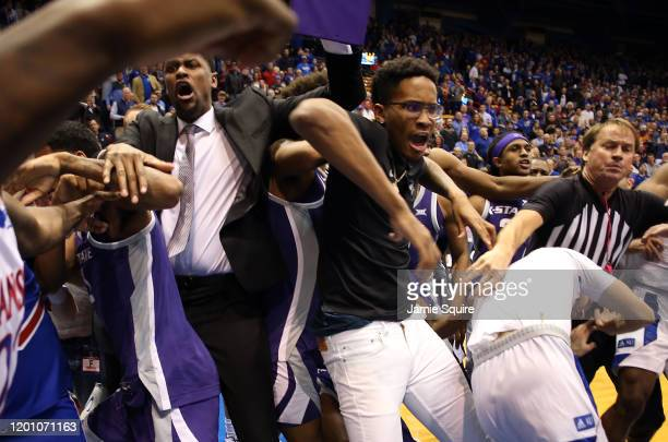 James Love III of the Kansas State Wildcats grabs Elijah Elliott of the Kansas Jayhawks during a brawl after the game at Allen Fieldhouse on January...