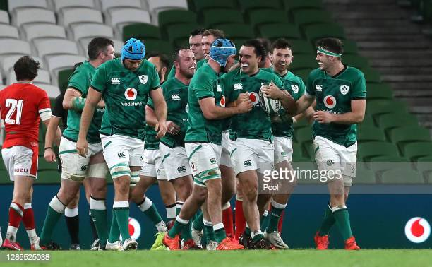 James Lowe of Ireland celebrates with team mates after scoring his team's second try during the Autumn Nations Cup 2020 match between Ireland and...