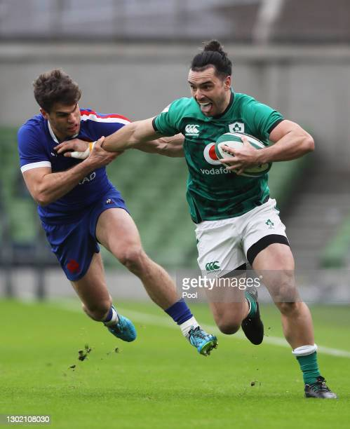 James Lowe of Ireland holds off Damian Penaud of France during the Guinness Six Nations match between Ireland and France at Aviva Stadium on February...