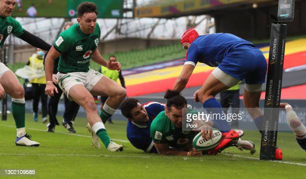 James Lowe of Ireland touches down as he is tackled by Brice Dulin of France but the try is disallowed during the Guinness Six Nations match between...