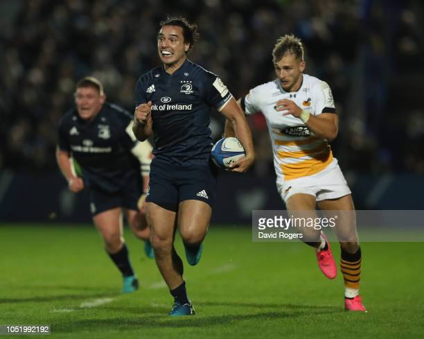 James Lowe of Leinster breaks clear of Josh Bassett to score his second try during the Champions Cup match between Leinster Rugby and Wasps at the...