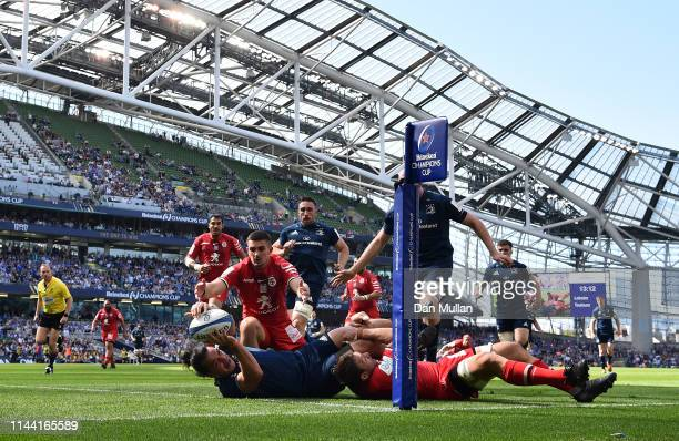 James Lowe of Leinster dives over for his side's first try during the Heineken Champions Cup Semi Final match between Leinster Rugby and Toulouse at...