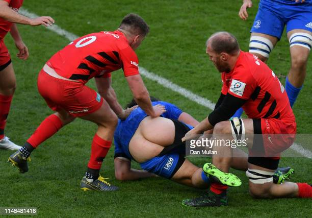 James Lowe of Leinster has his shorts pulled down in a tackle from Schalk Burger of Saracens during the Champions Cup Final match between Saracens...