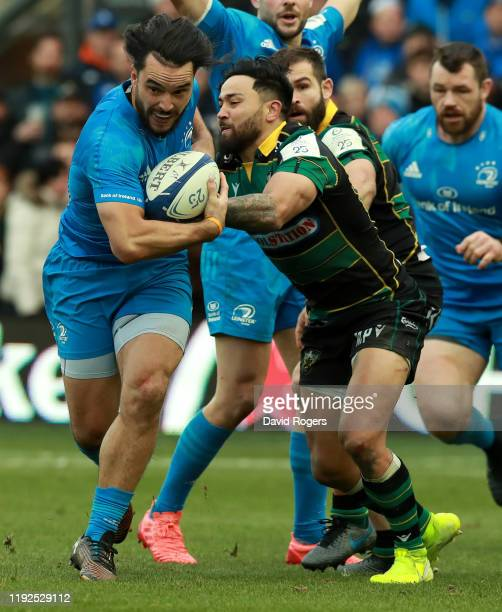 James Lowe of Leinster is tackled by Matt Proctor during the Heineken Champions Cup Round 3 match between Northampton Saints and Leinster Rugby at...