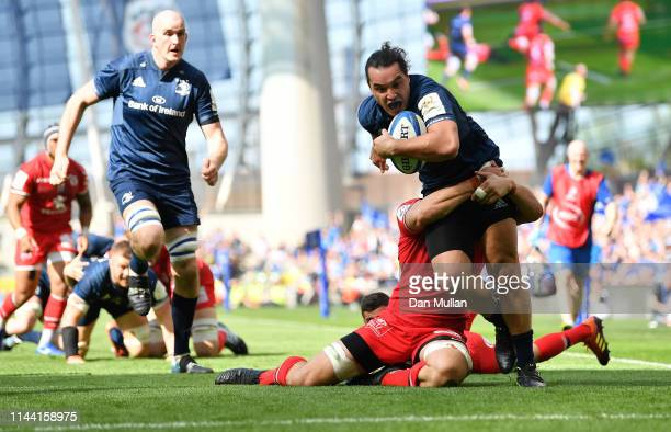 James Lowe of Leinster is tackled by Rynhard Elstadt of Toulouse as he dives over for his side's first try during the Heineken Champions Cup Semi...