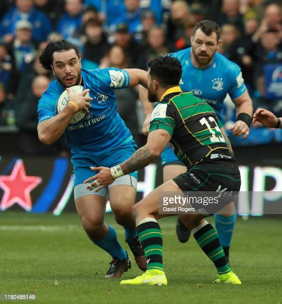 James Lowe of Leinster takes on Matt Proctor during the Heineken Champions Cup Round 3 match between Northampton Saints and Leinster Rugby at...