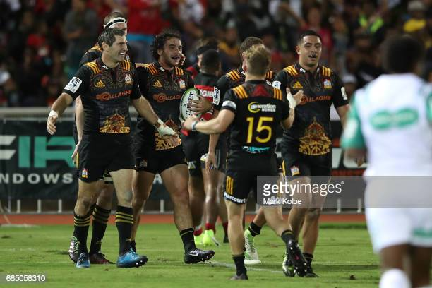 James Lowe of the Chiefs celebrates with his team mates after scoring a try during the round 13 Super Rugby match between the Chiefs and the...
