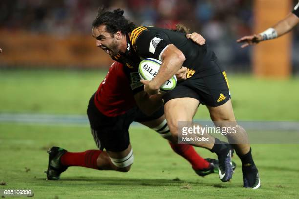 James Lowe of the Chiefs is tackled during the round 13 Super Rugby match between the Chiefs and the Crusaders at ANZ Stadium on May 19 2017 in Suva...