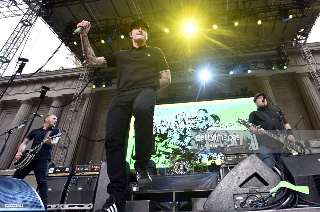 James Lynch, Al Barr and Ken Casey of Dropkick Murphys perform during the 'From Boston to Berkeley' tour at University of California, Berkeley on August 20, 2017 in Berkeley, California.