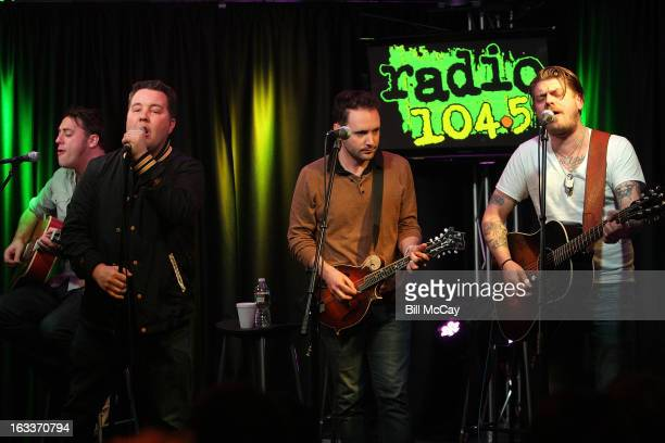 James Lynch Ken Casey Tim Brennan and Jeff DaRosa of Dropkick Murphys perform at Radio Station Q102 iHeartRadio Performance Theater March 8 2013 in...