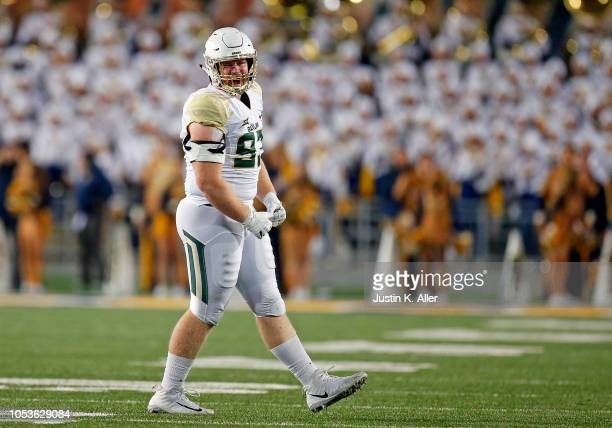 James Lynch of the Baylor Bears celebrates after a sack in the first half against the West Virginia Mountaineers at Mountaineer Field on October 25...