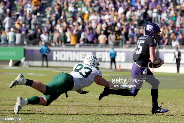 James Lynch of the Baylor Bears trips up Max Duggan of the TCU Horned Frogs on third down in in triple overetime at Amon G. Carter Stadium on...