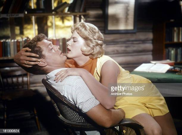 James MacArthur is seduced by Mimsy Farmer in a scene from the film 'Spencer's Mountain' 1963