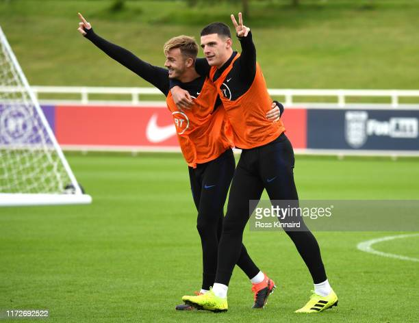 James Maddison and Declan Rice celebrate during an England training session at St Georges Park on September 06 2019 in BurtonuponTrent England