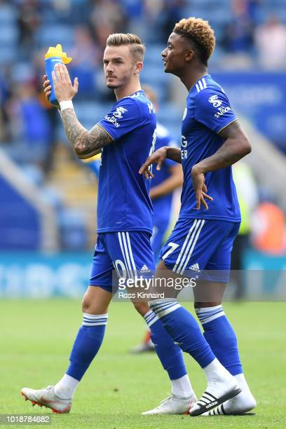 James Maddison and Demarai Gray of Leicester City applaud fans after the Premier League match between Leicester City and Wolverhampton Wanderers at...