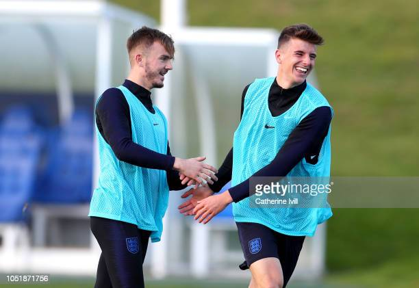 James Maddison of England and Mason Mount of England laugh together during the England Training Session at St Georges Park on October 11 2018 in...